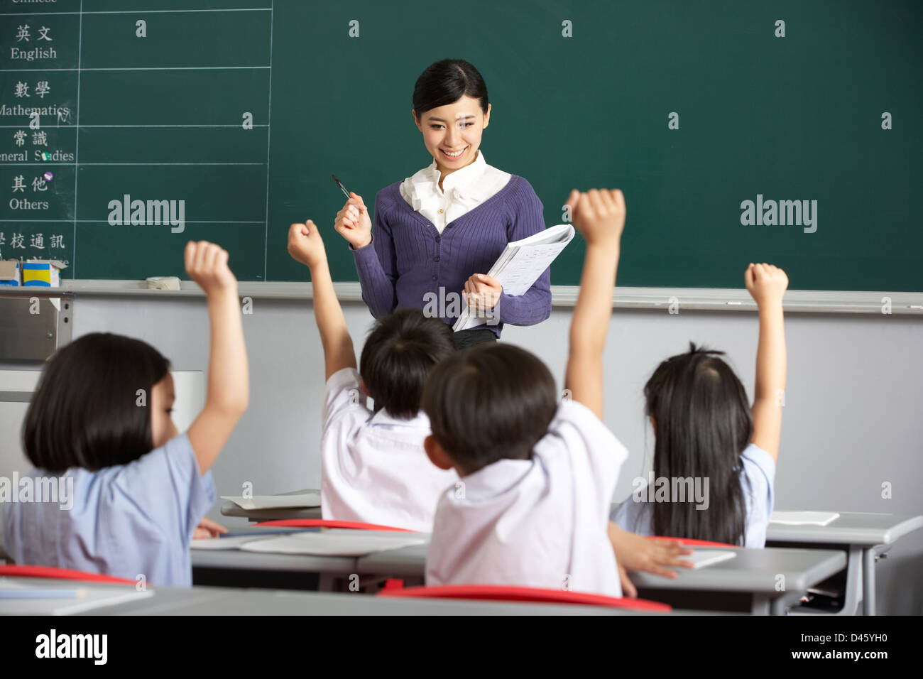 Teacher With Students In Chinese School Classroom - Stock Image