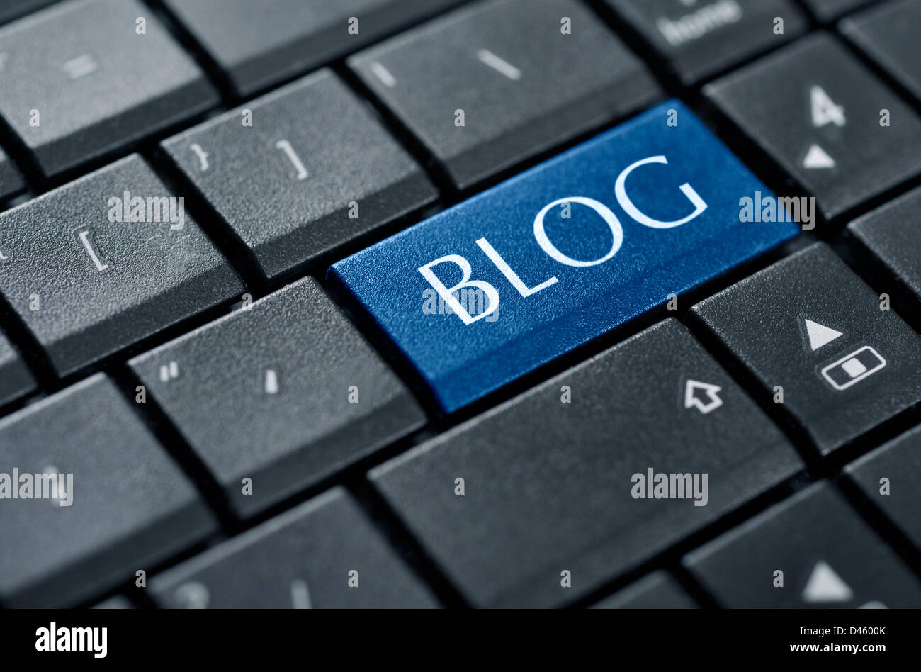 Modern keyboard with blog text on enter key. - Stock Image