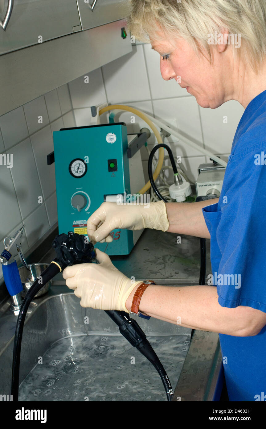An endoscope being hand-washed before cleaning and sterillizing by machine after being used for an invasive medical - Stock Image