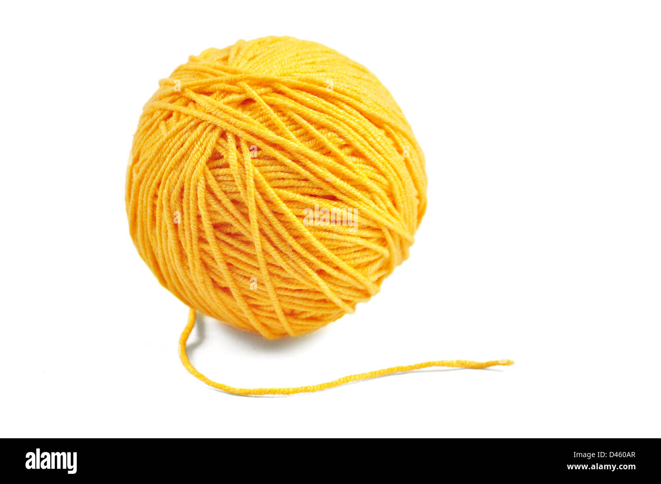 Yellow wool yarn ball isolated on white background - Stock Image