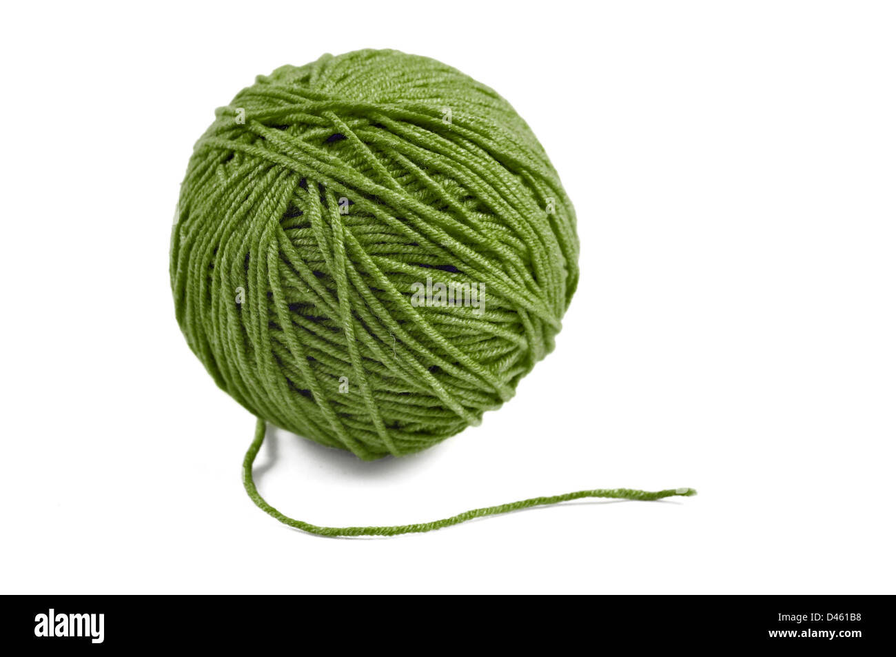 Green wool yarn ball isolated on white background - Stock Image