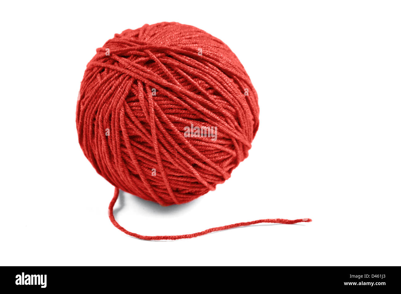 Red wool yarn ball isolated on white background - Stock Image