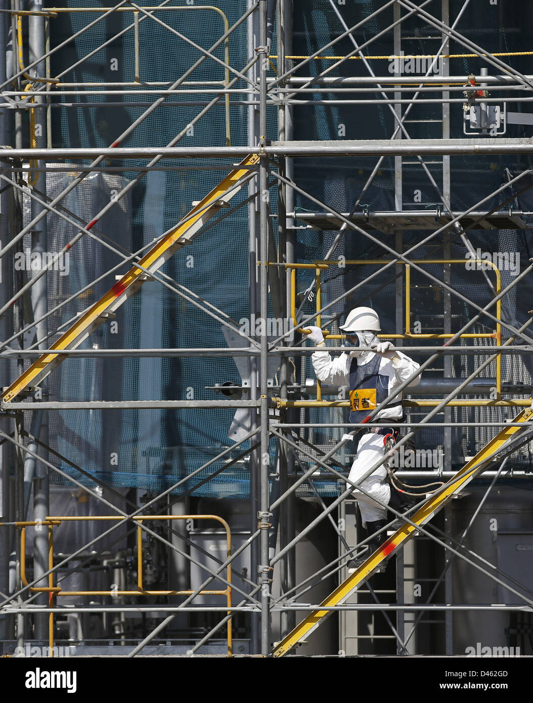 Fukushima, Japan. 6th March 2013. A worker wearing protective suit and mask is seen at an being constructed Multi Stock Photo