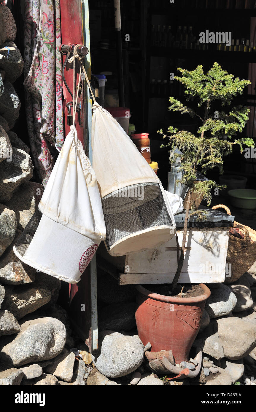 Beekeeping hats outside hanging from shop door in the small village of Setti Fatma, Ourika Valley, Morocco Stock Photo