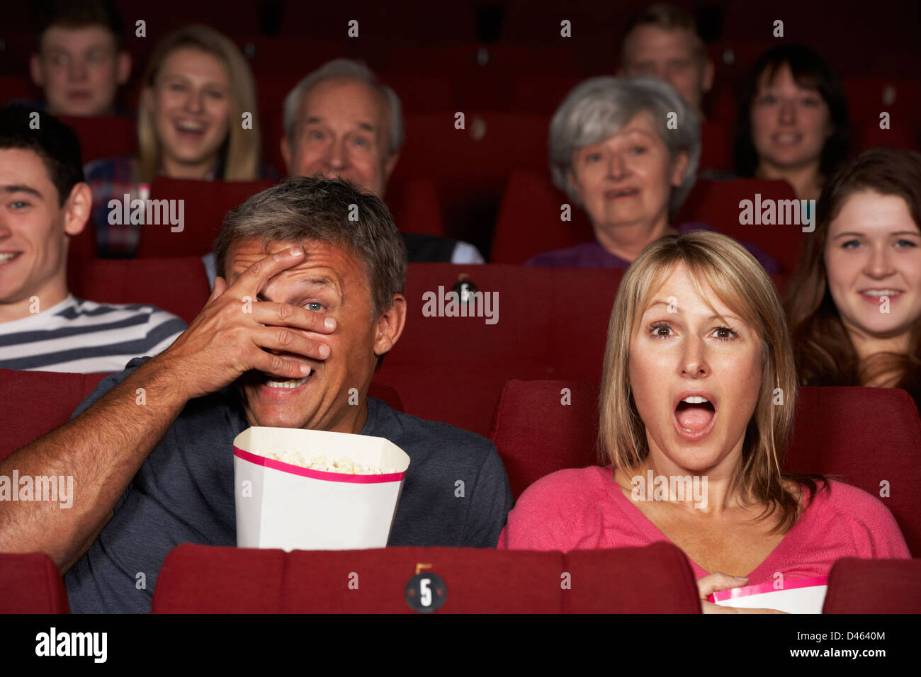 Couple Watching Film In Cinema Stock Photo