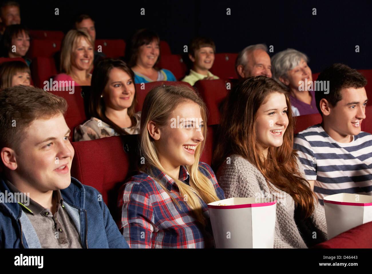 Group Of Teenage Friends Watching Film In Cinema Stock Photo