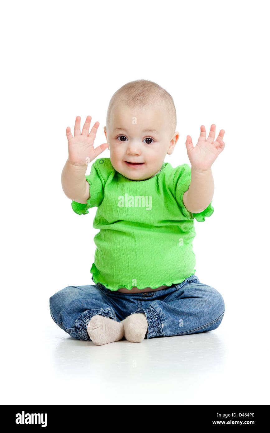 small baby girl sitting on floor - Stock Image