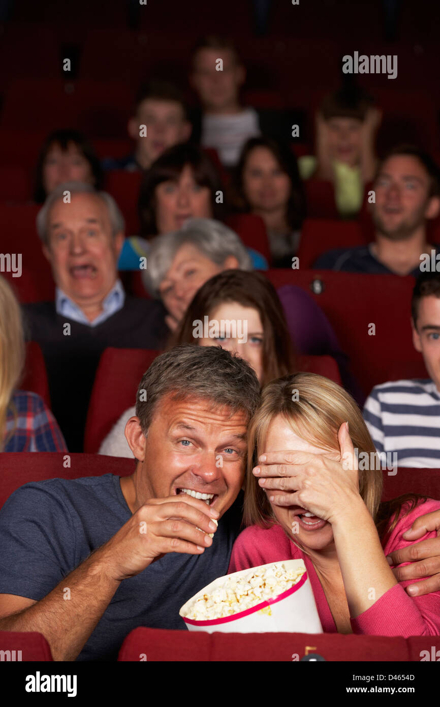 Couple Watching Film In Cinema - Stock Image