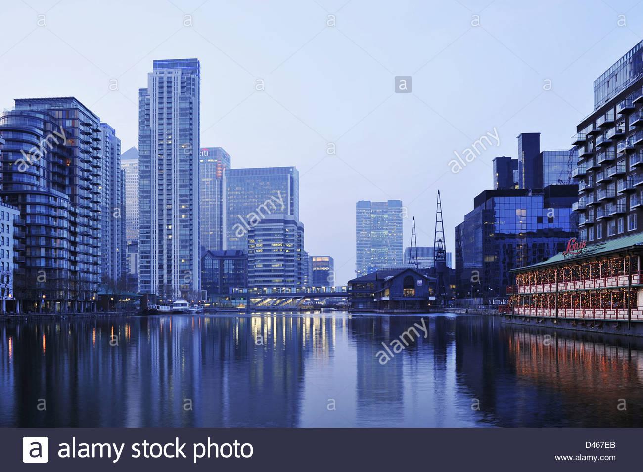 Pan Peninsula modern residential developments and marina, misty evening on Isle of Dogs east London UK. - Stock Image