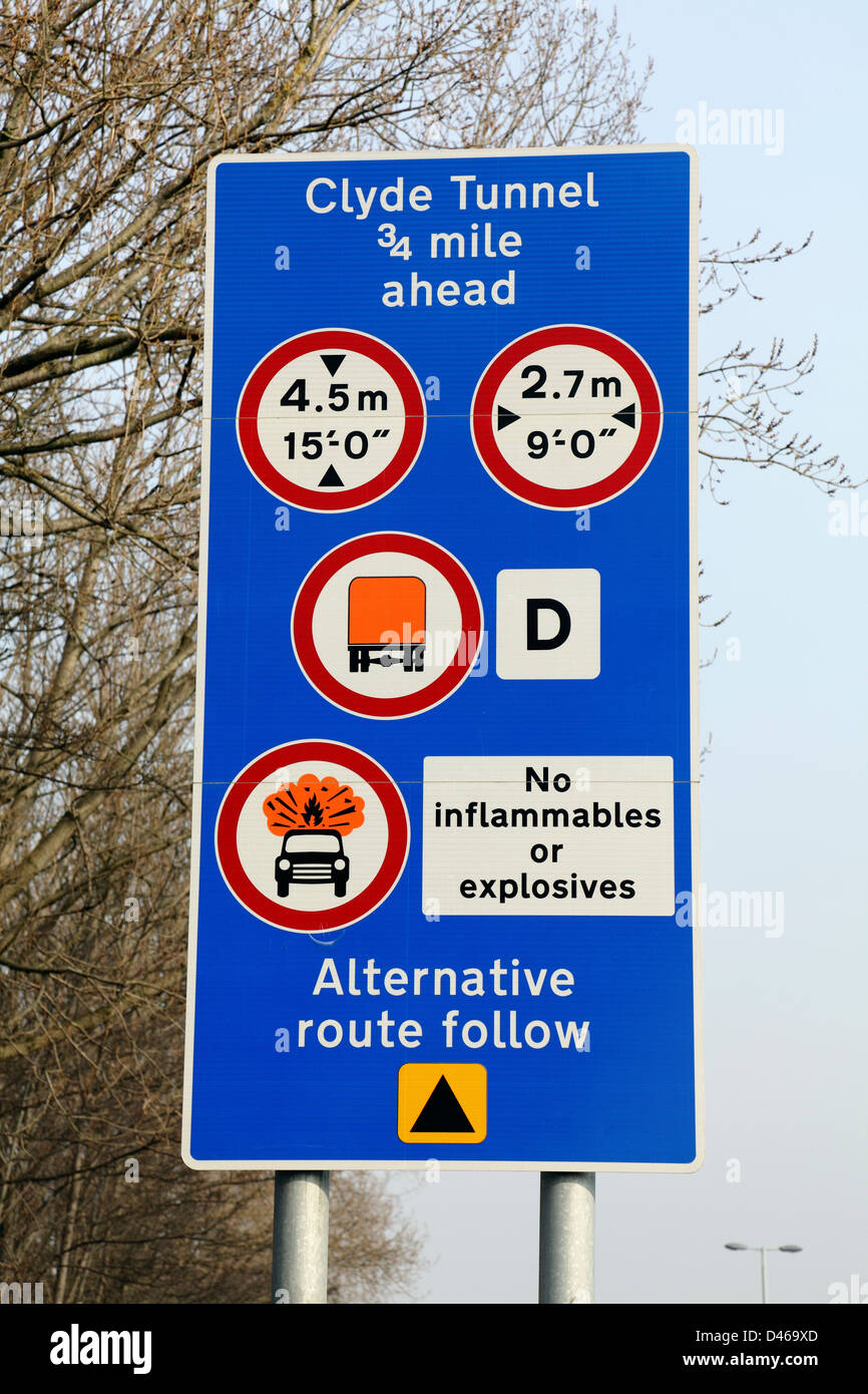 A sign with multiple instructions and warnings at the entrance to the Clyde Tunnel in Glasgow, Scotland, UK - Stock Image