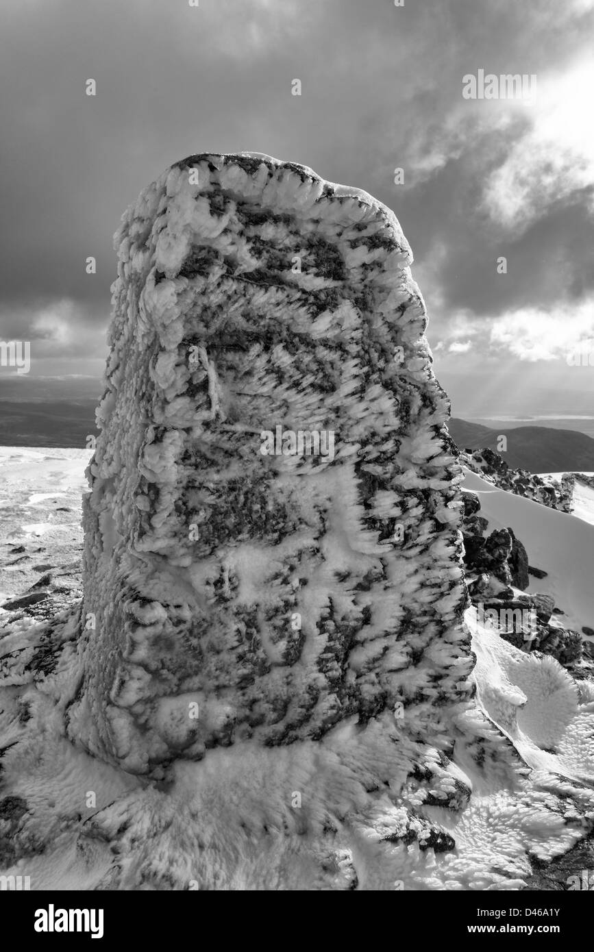 The summit trig point on Moel Hebog in winter Stock Photo