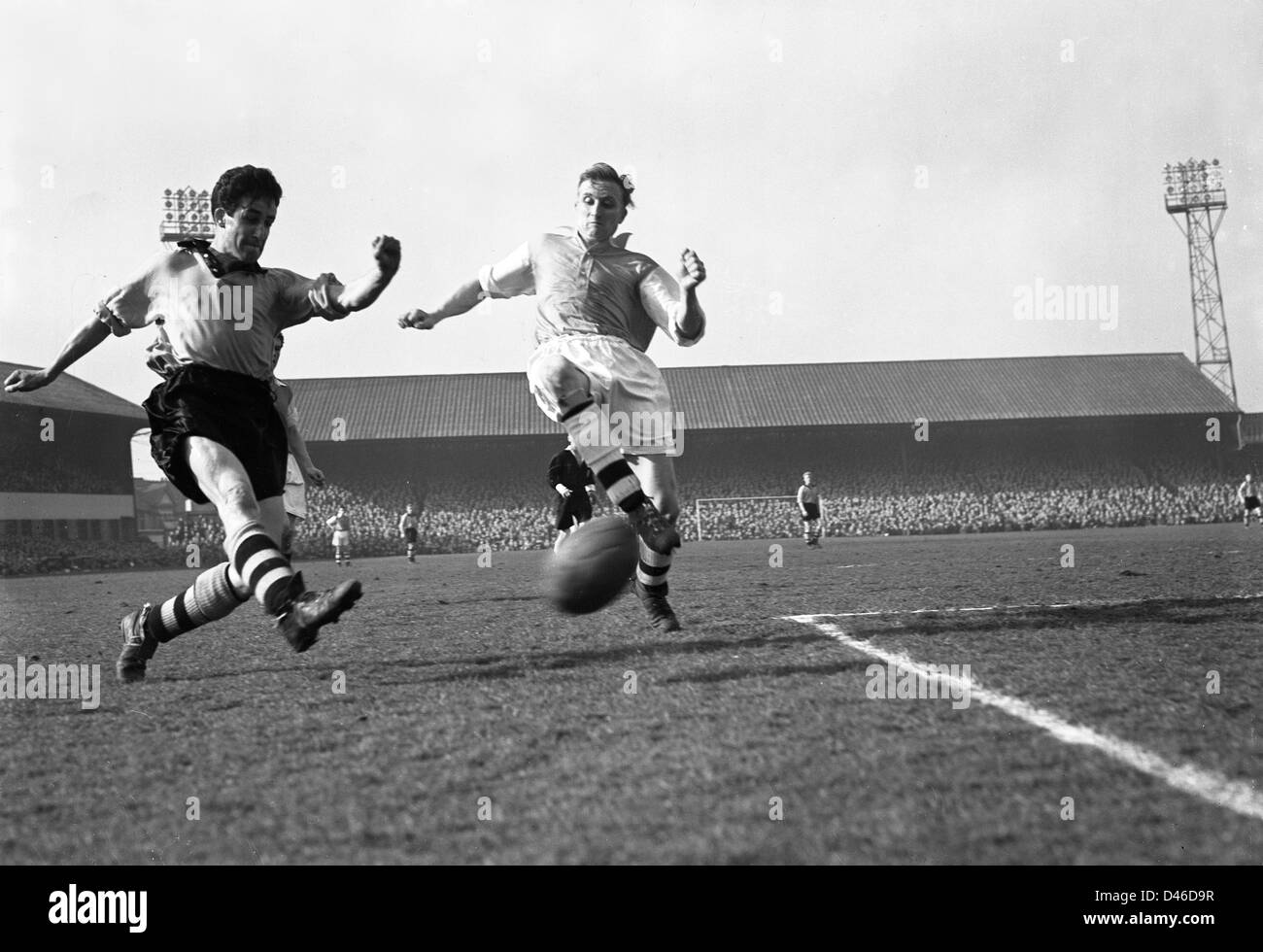 Wolverhampton Wanderers FC in action against Arsenal at Molineux in the 1950s Colin Booth of Wolves and Peter Goring - Stock Image