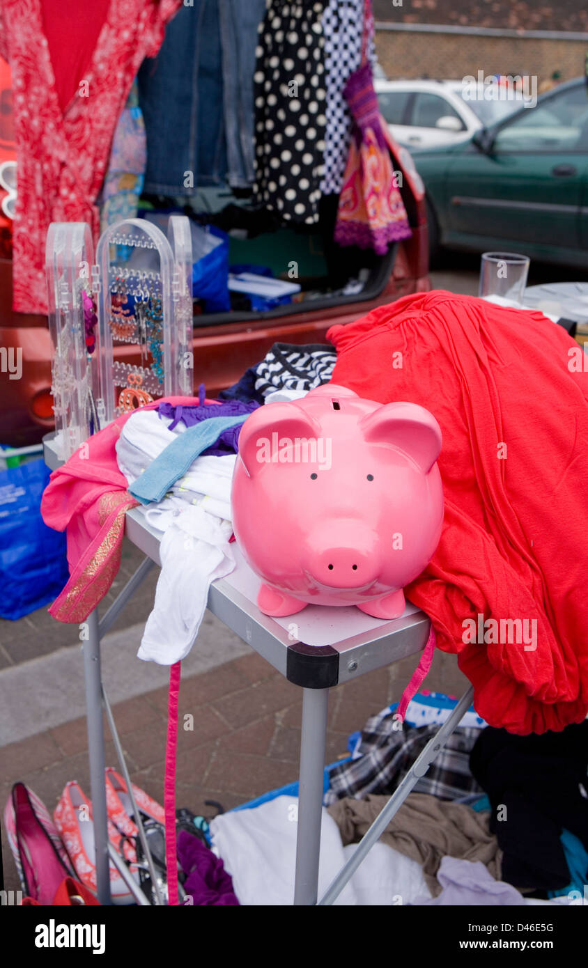 piggy bank adventures at the car boot - Stock Image