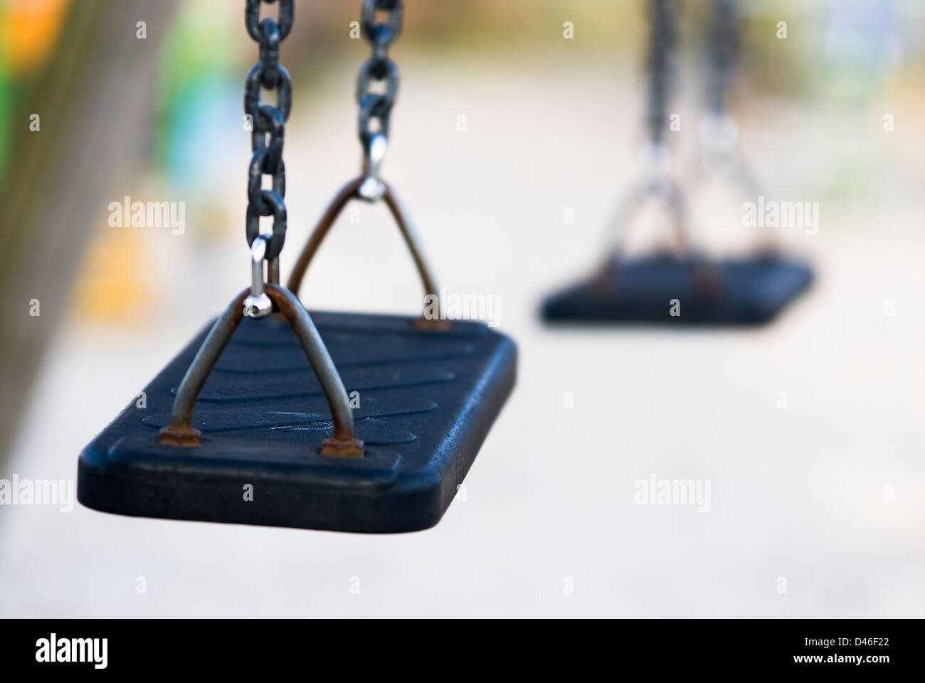 no children swings in a playground, solitary - Stock Image