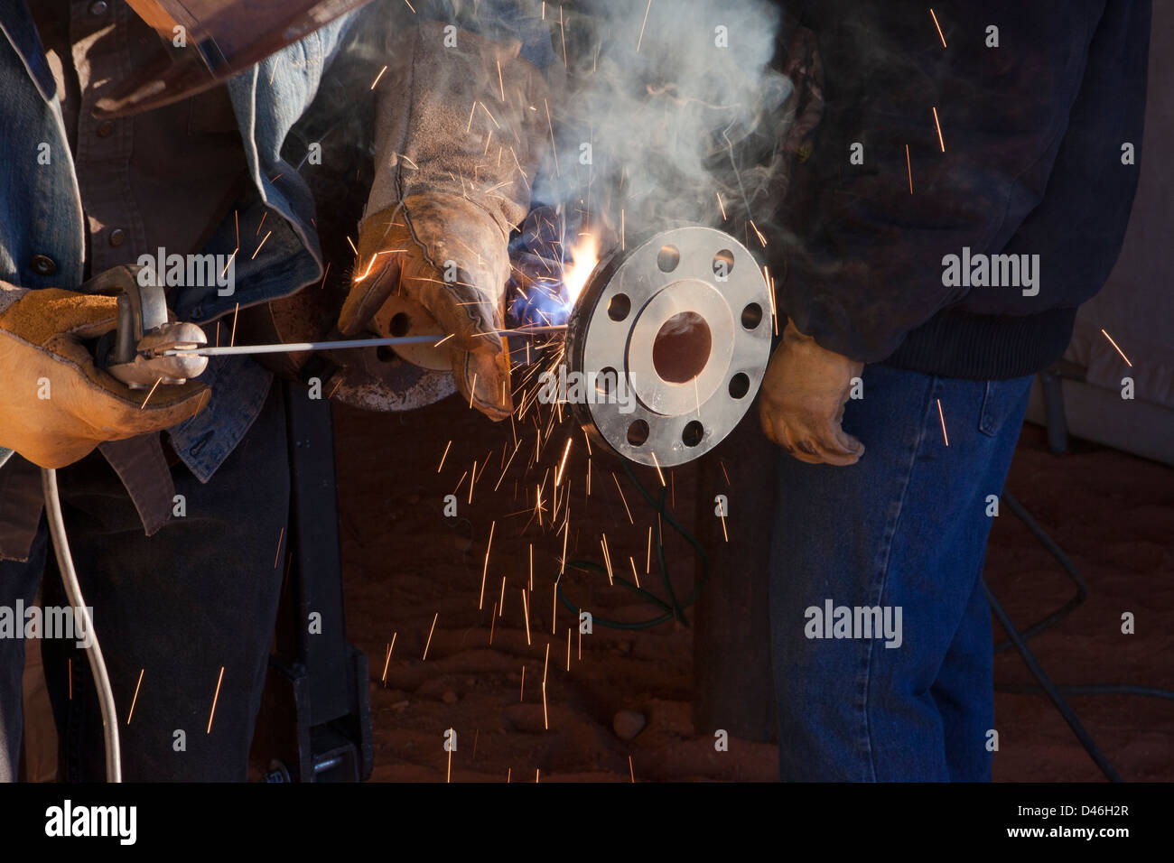 Welder Working on a Oil Pipelines - Stock Image