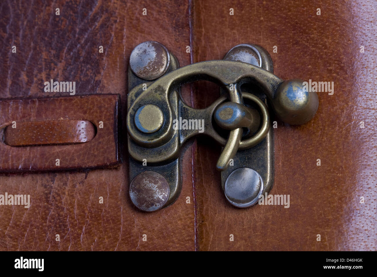 Closeup of vintage lock of an old leather man's bag - Stock Image