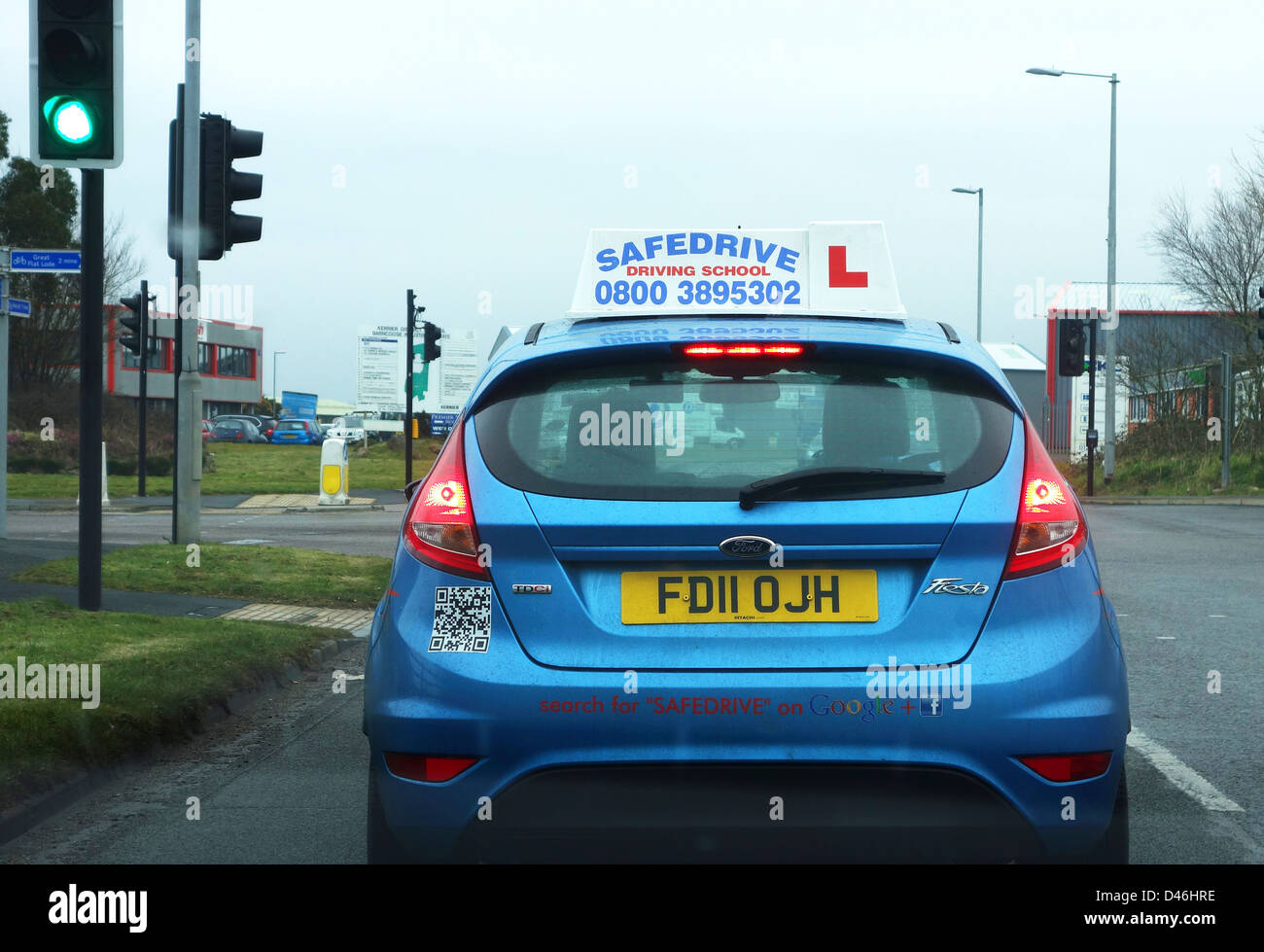 A learner driver at traffic lights - Stock Image