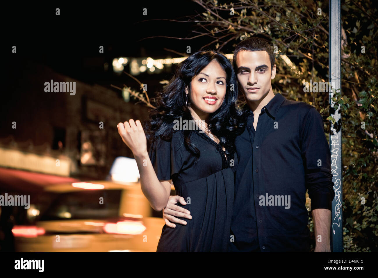 A glamorous and fashionable young couple on a night out - Stock Image