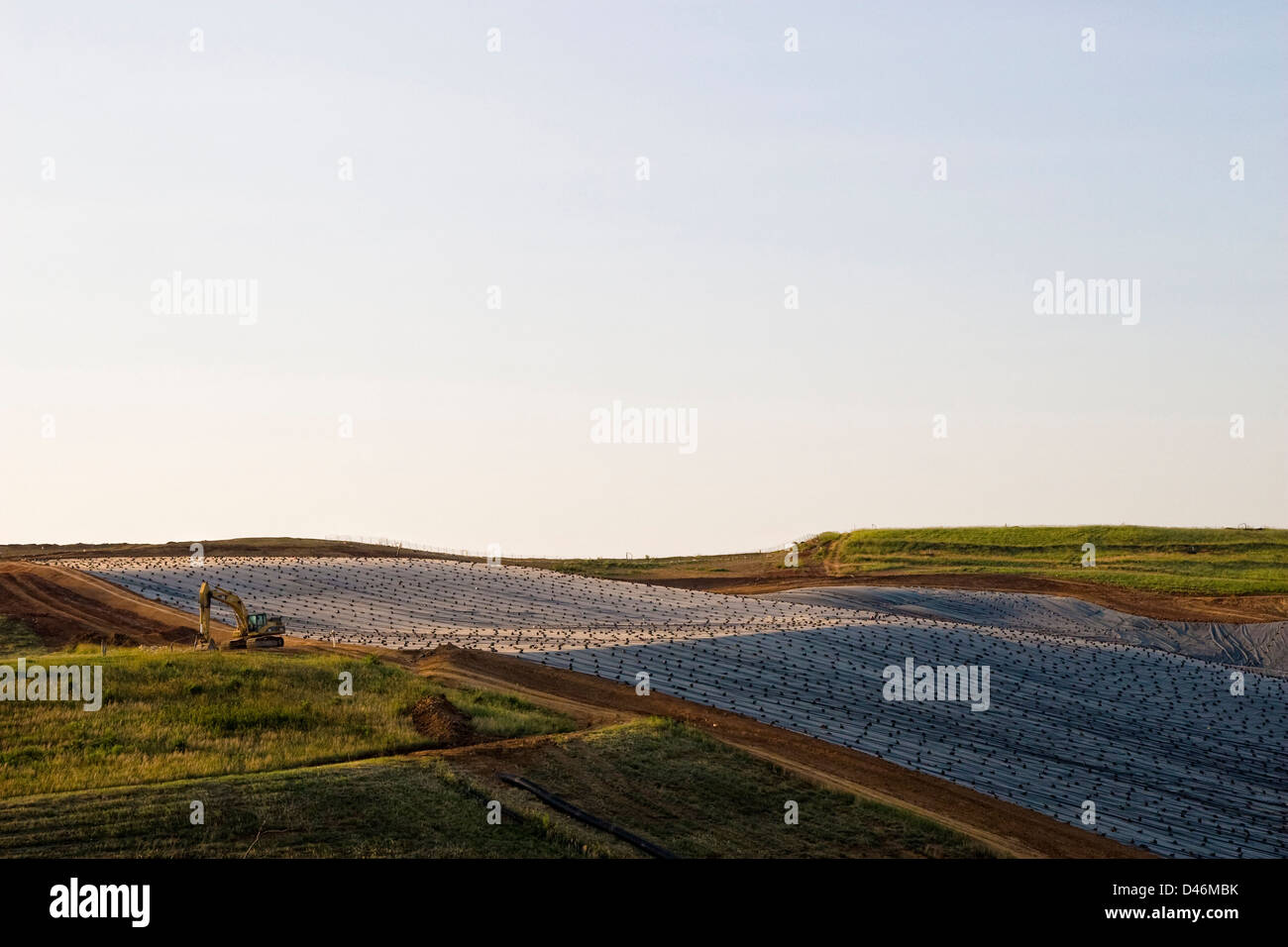A landfill in the evening sun. - Stock Image