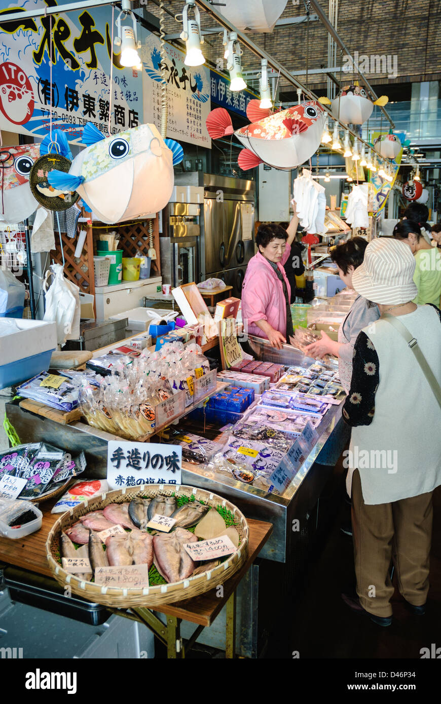 Poisonous fugu (puffer fish) and other seafood on sale at an indoor seafood market in Japan; Japanese fish market; - Stock Image