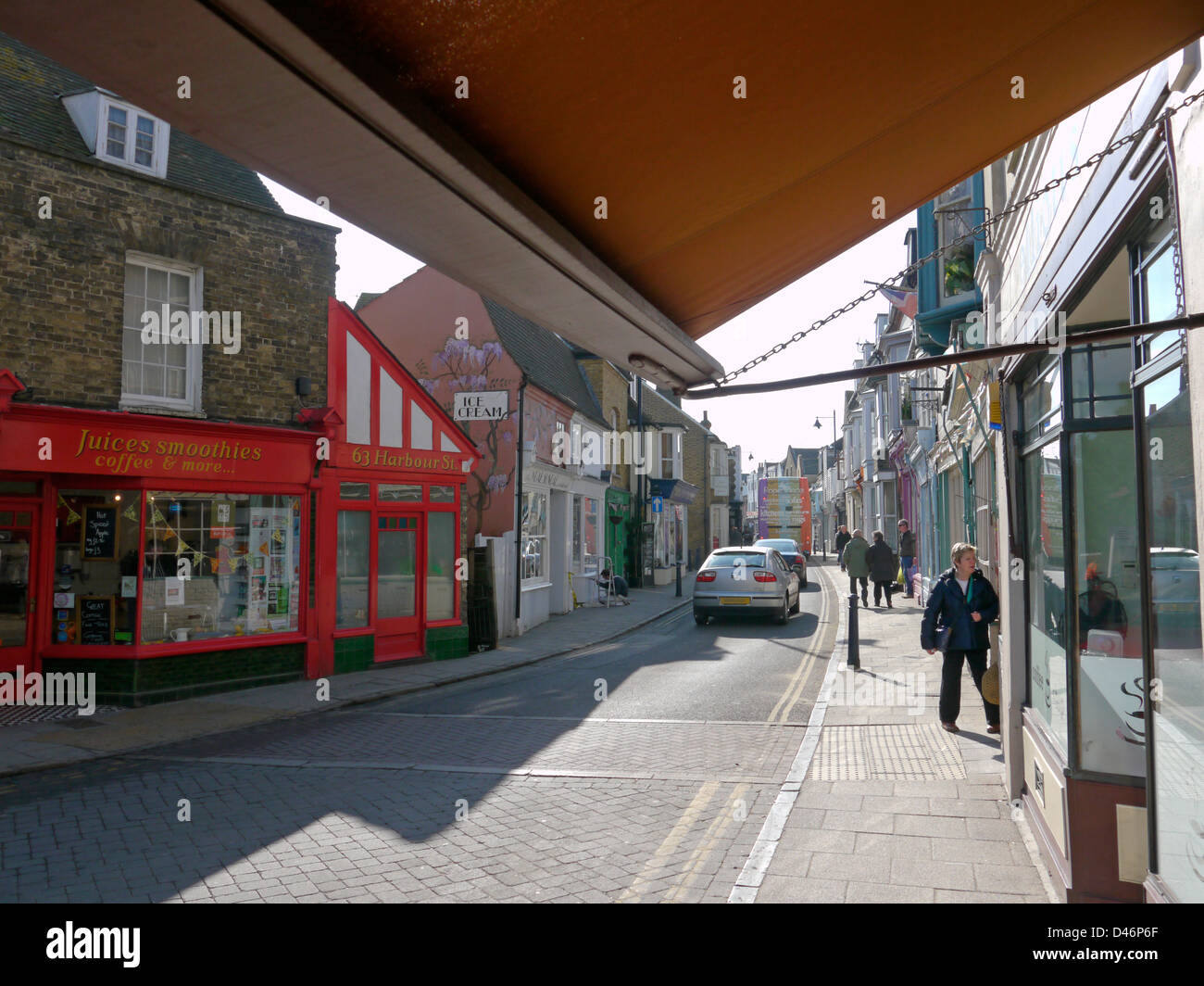 Awnings on Whitstable high street - Stock Image