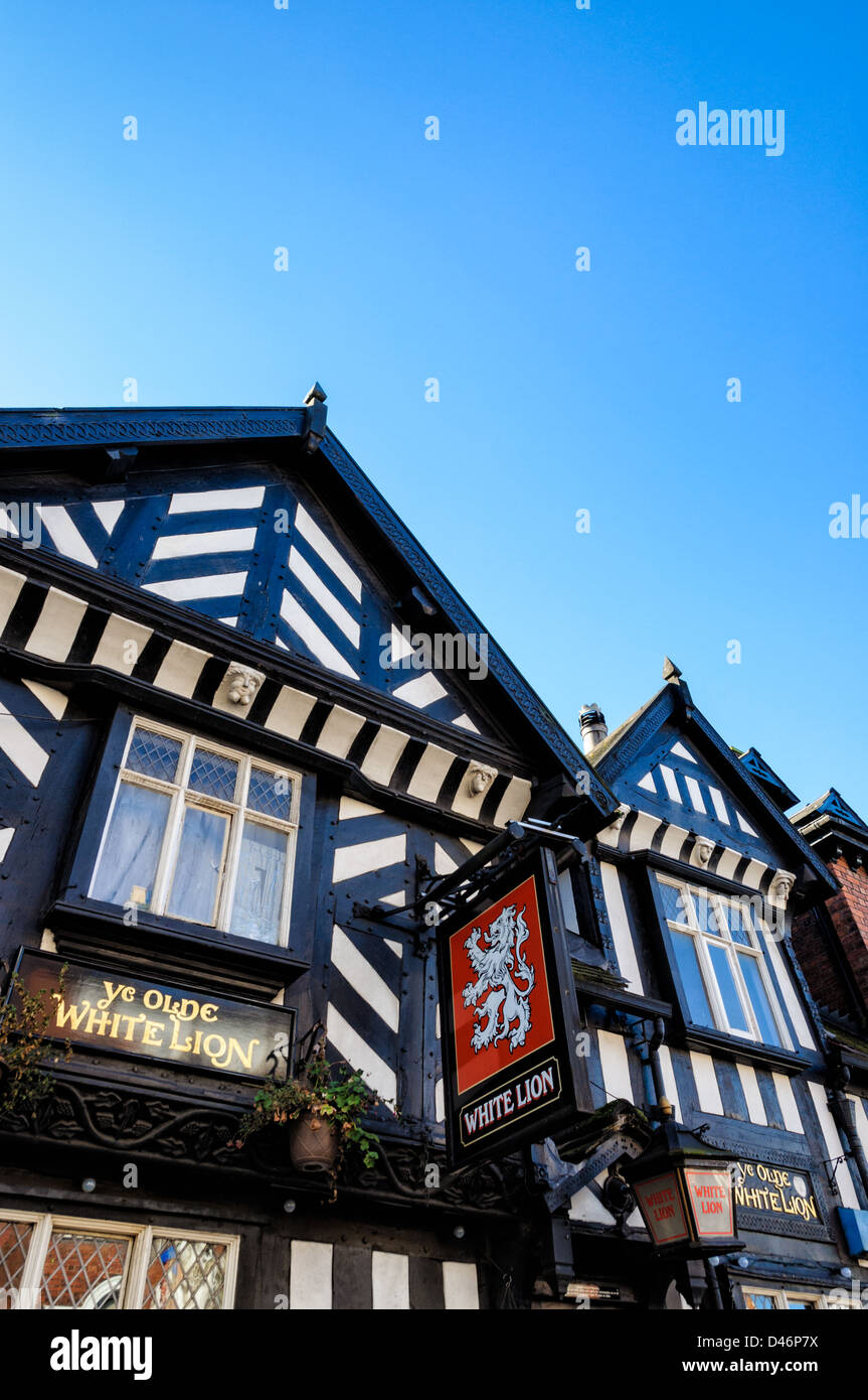 Old traditional English pub from the Tudor era, showing pub sign and half timbered ('black and white') construction. - Stock Image