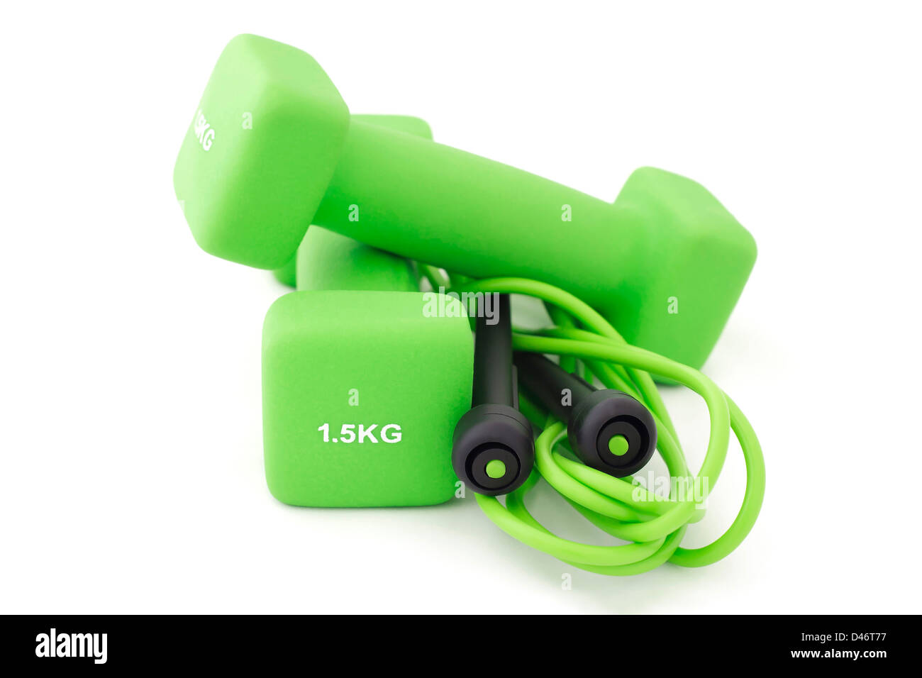 Green 1.5 kg dumbbells and skipping rope for a fitness training - Stock Image