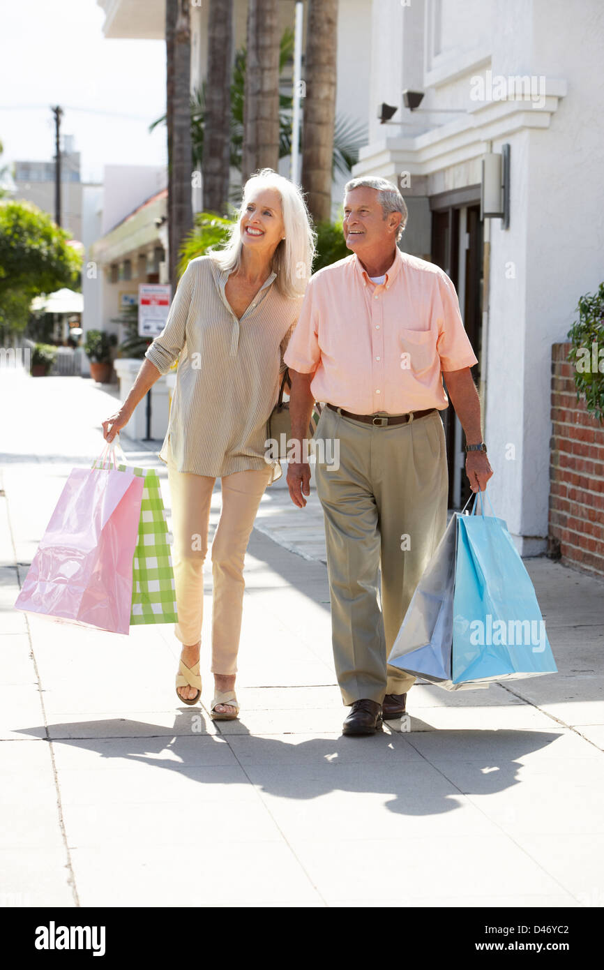 Senior Couple Carrying Shopping Bags - Stock Image