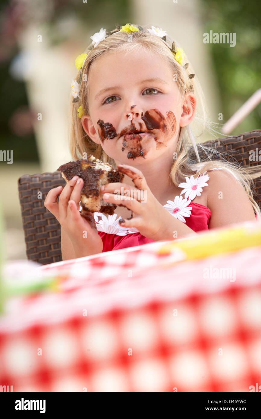 Messy Girl Eating Chocolate Cake - Stock Image