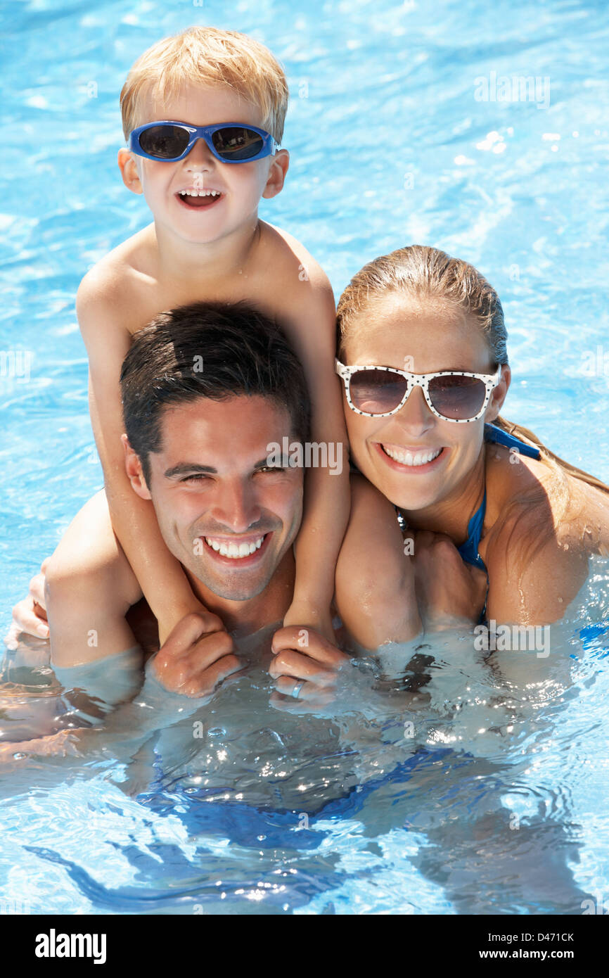 Family Having Fun In Swimming Pool Stock Photo