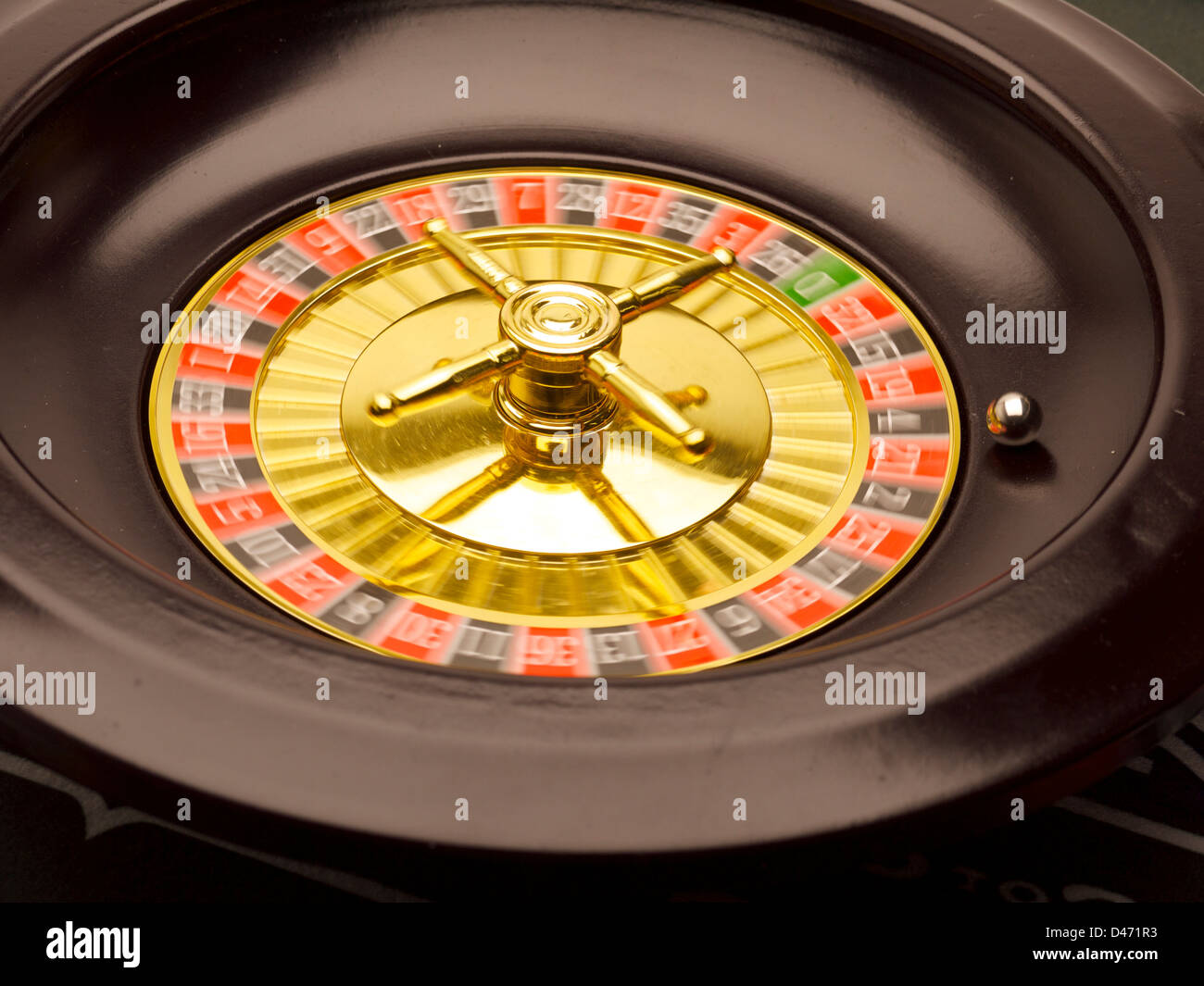 Spinning Roulette wheel with ball. - Stock Image