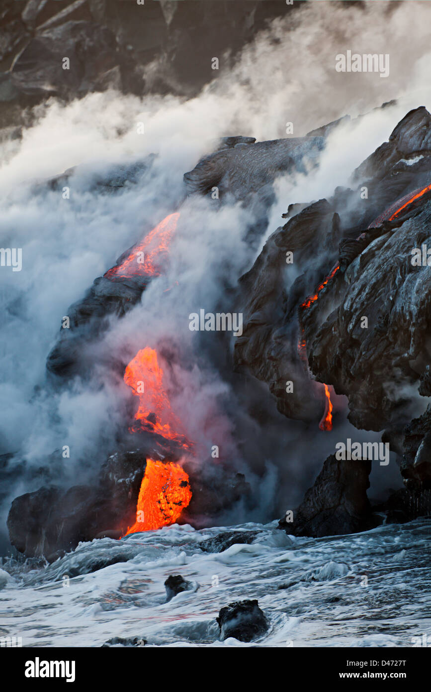 The Pahoehoe lava flowing from Kilauea has reached the Pacific ocean near Kalapana, Big Island, Hawaii. - Stock Image