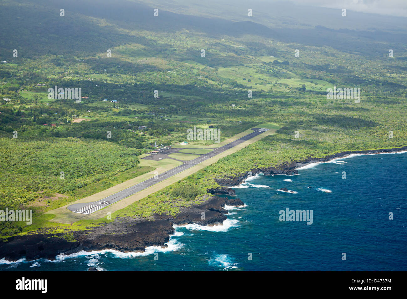 An aerial view of Hana's Airport next to the Pacific Ocean on the east shore of the island of Maui, Hawaii. - Stock Image