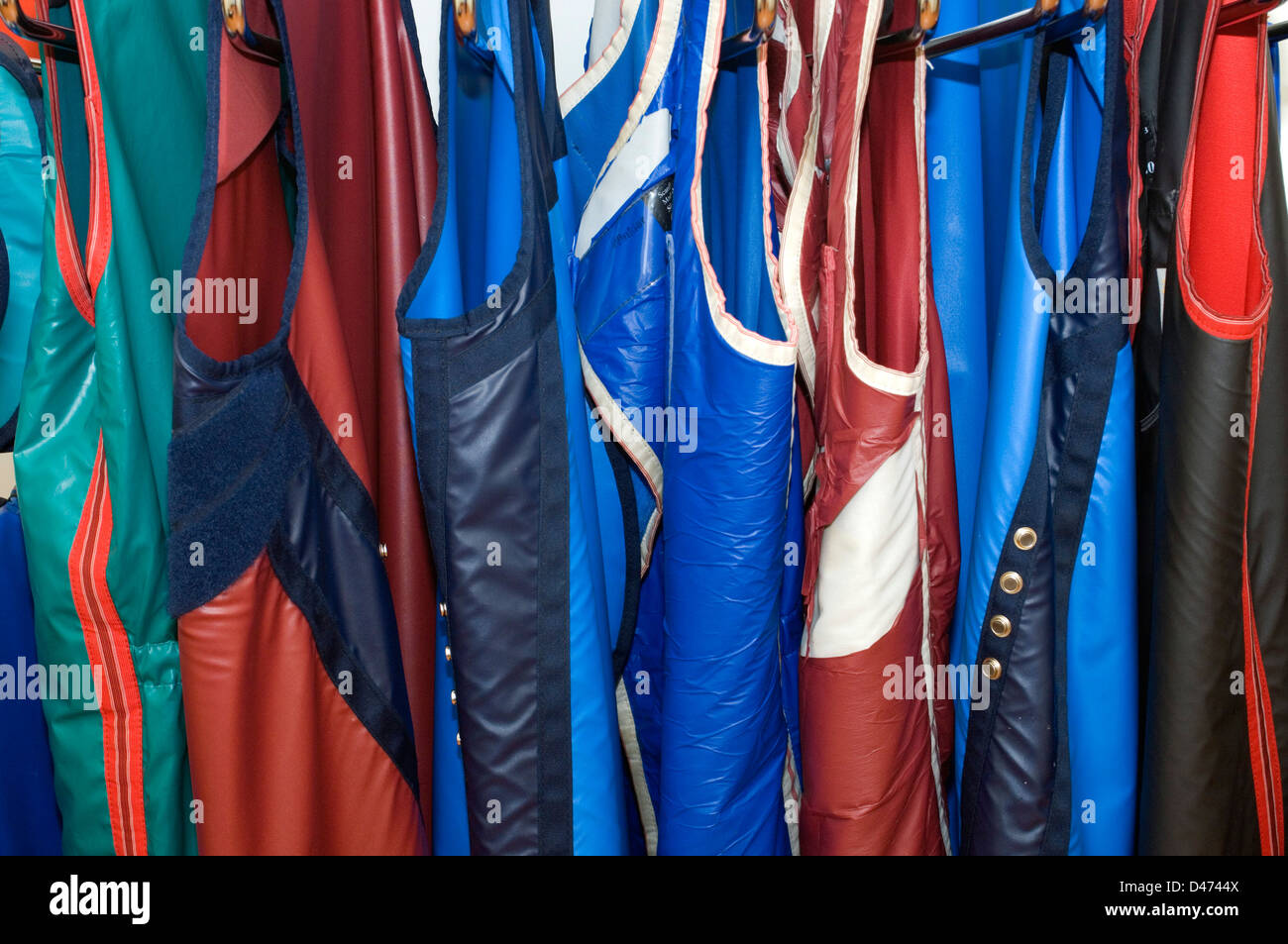 A selection of multi-coloured lead-lined jackets. - Stock Image