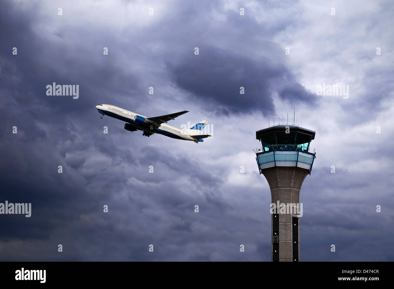 Air Traffic Control Tower with a Plane Taking Off. Luton Airport, UK. - Stock Image
