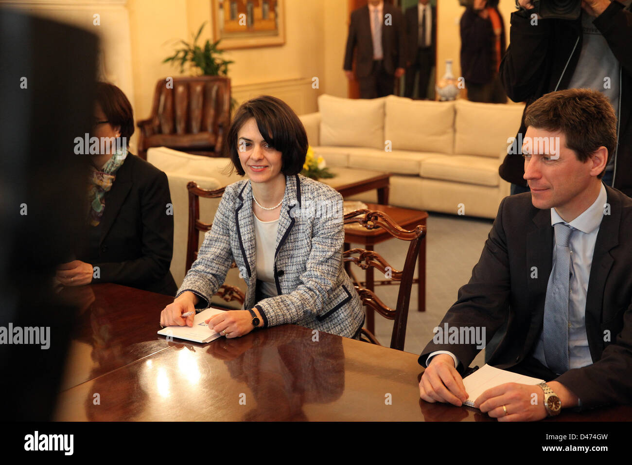 Nicosia, Cyprus. 7th March 2013. From Left to right Delia Velculescu from IMF and Maarten Verwey from European Commision - Stock Image