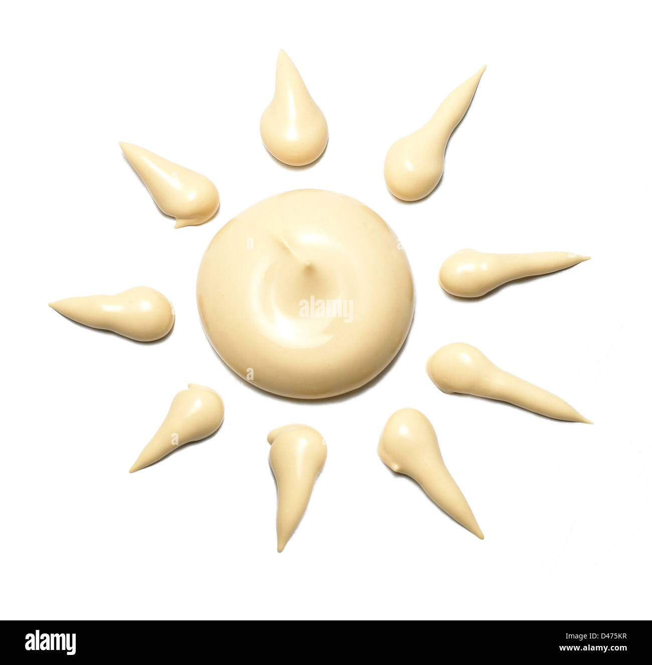 Sun tan lotion shaped as the sun cut out white background - Stock Image