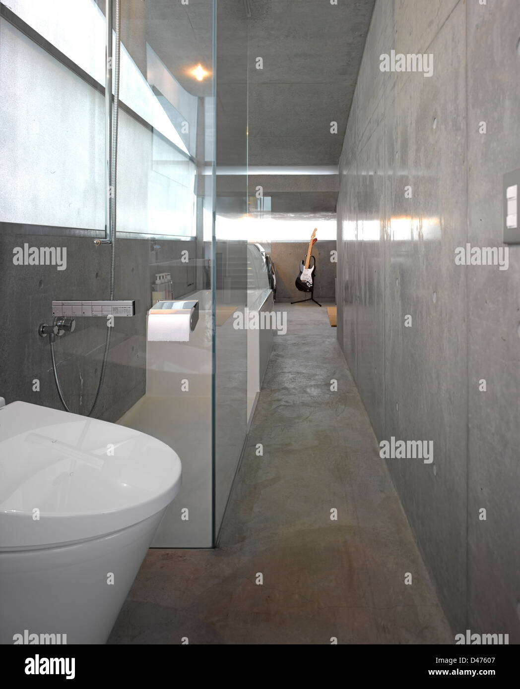 The Mist House, Tokyo, Japan. Architect: TNA, 2012. Basement area showing loo and shower. Stock Photo