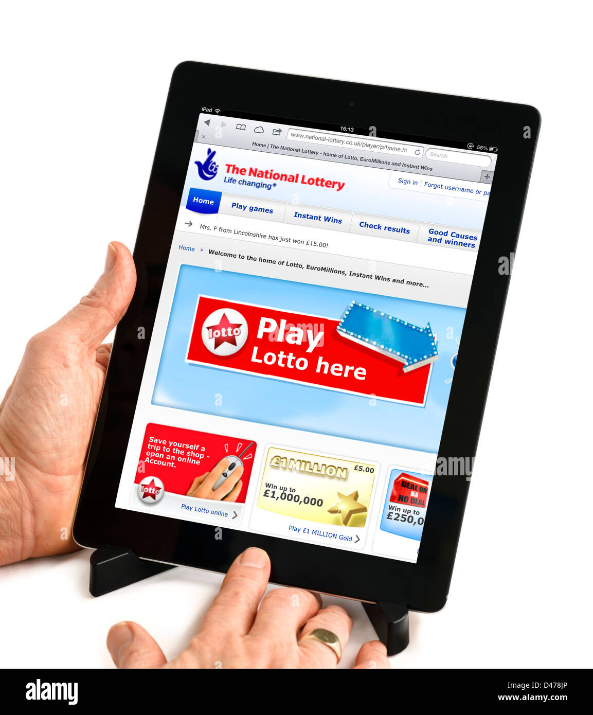 The UK National Lottery website viewed on an iPad 4, UK - Stock Image