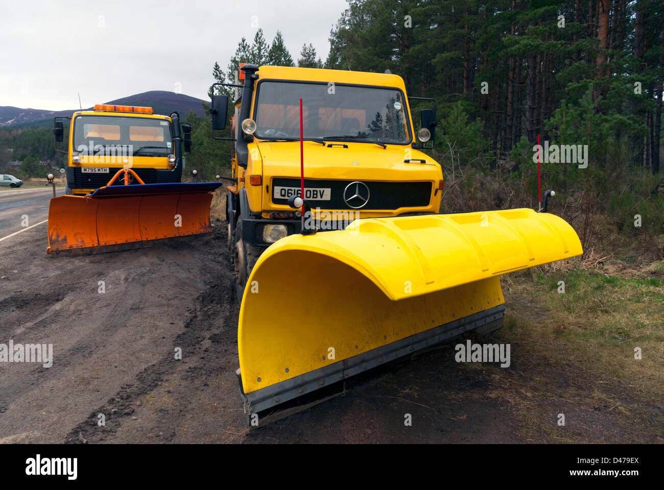 Two snowploughs in Glenmore Forest Park, near Aviemore Stock Photo