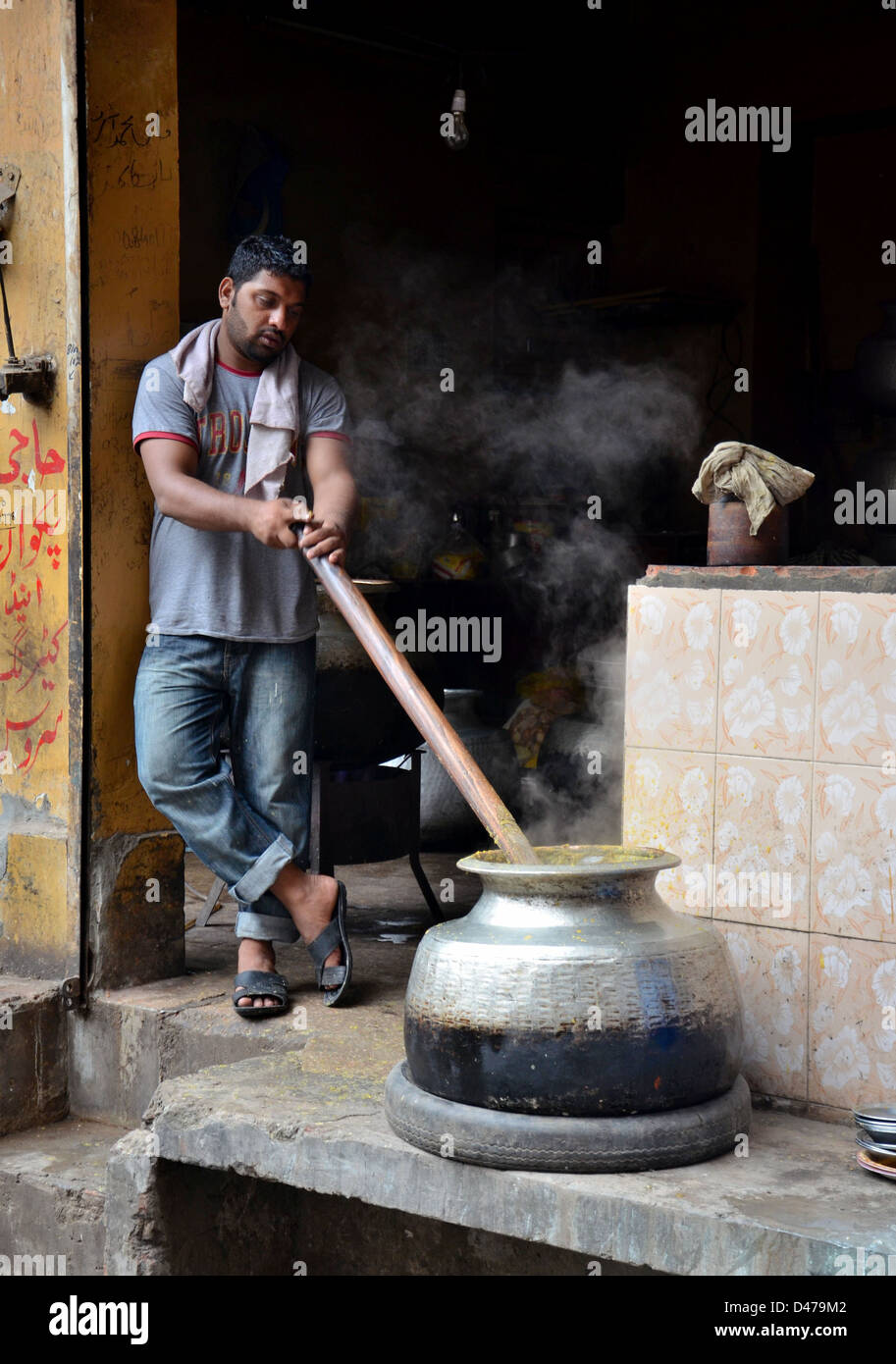 Cooking breakfast early morning Lahore Pakistan - Stock Image