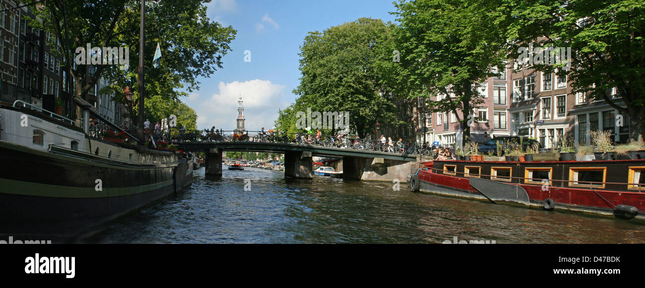 The Netherlands Holland Amsterdam Bridge Prinsengracht Canal District Westertoren House boats - Stock Image