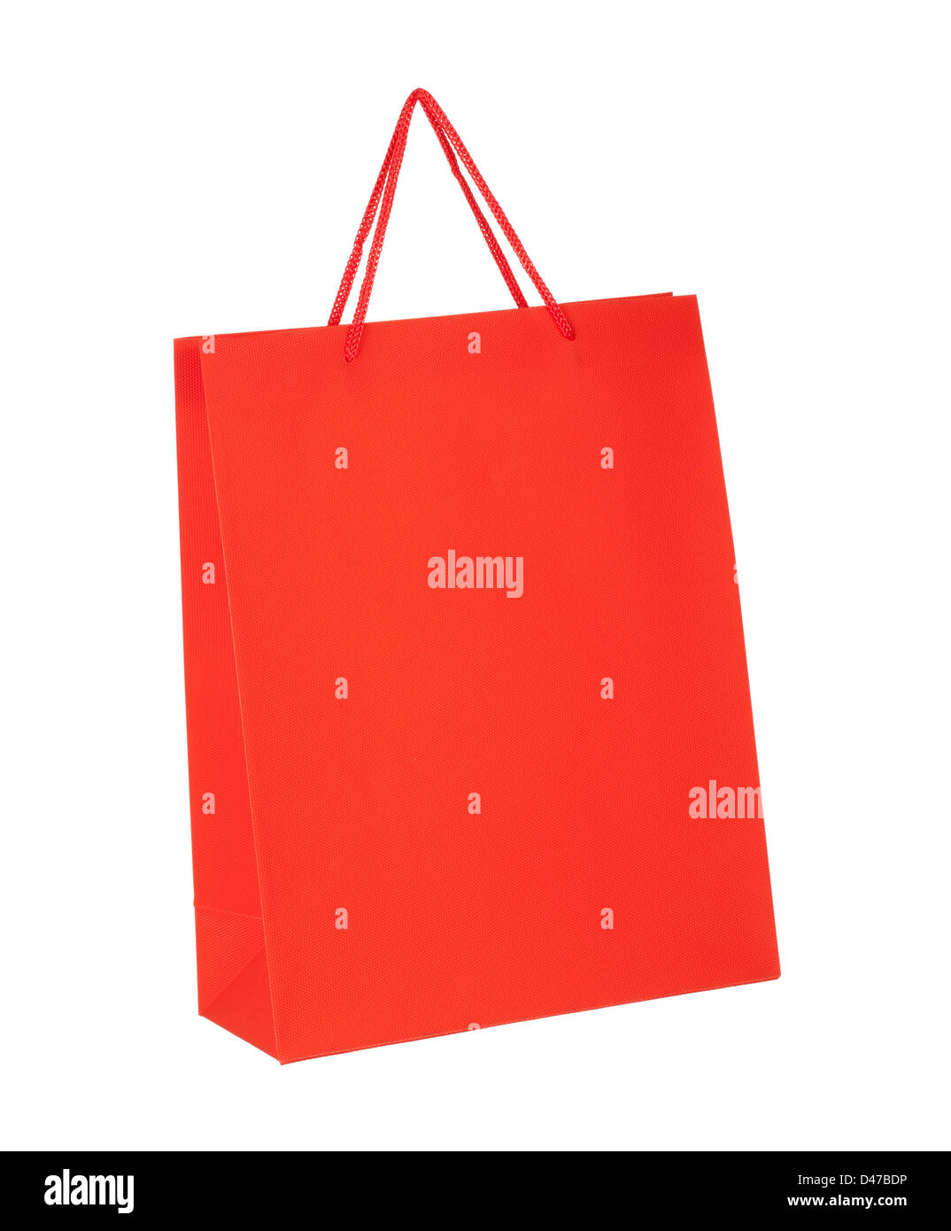 Red shopping paper bag isolated on white background - Stock Image