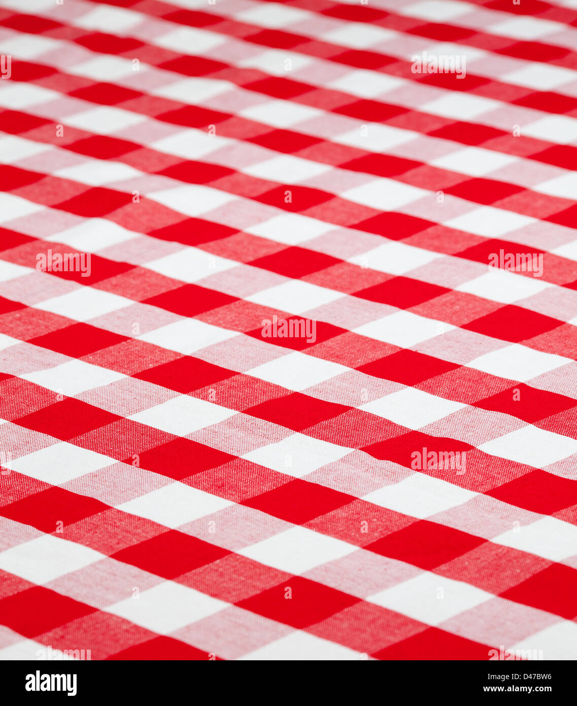 red checked fabric tablecloth - Stock Image