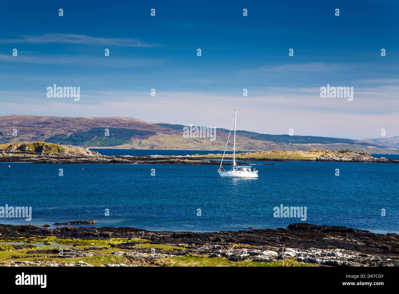 Sailing boat anchored at Kilchoan, Ardnamurchan, Highlands, Scotland uk - Stock Image