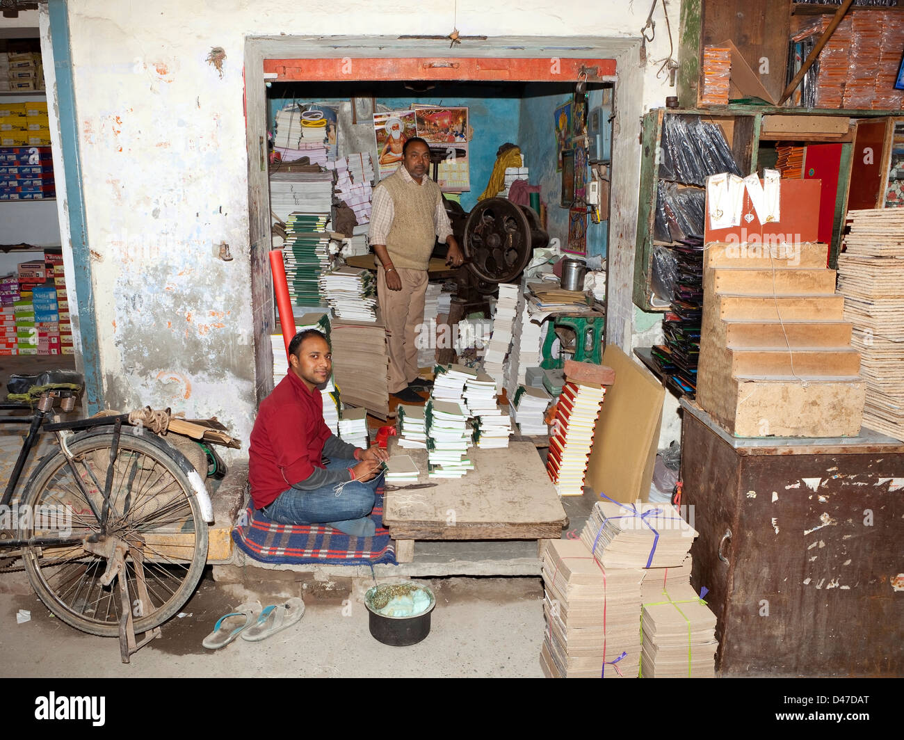Two men busy at their book binding business in their small shop on the streets of Amritsar Punjab India - Stock Image