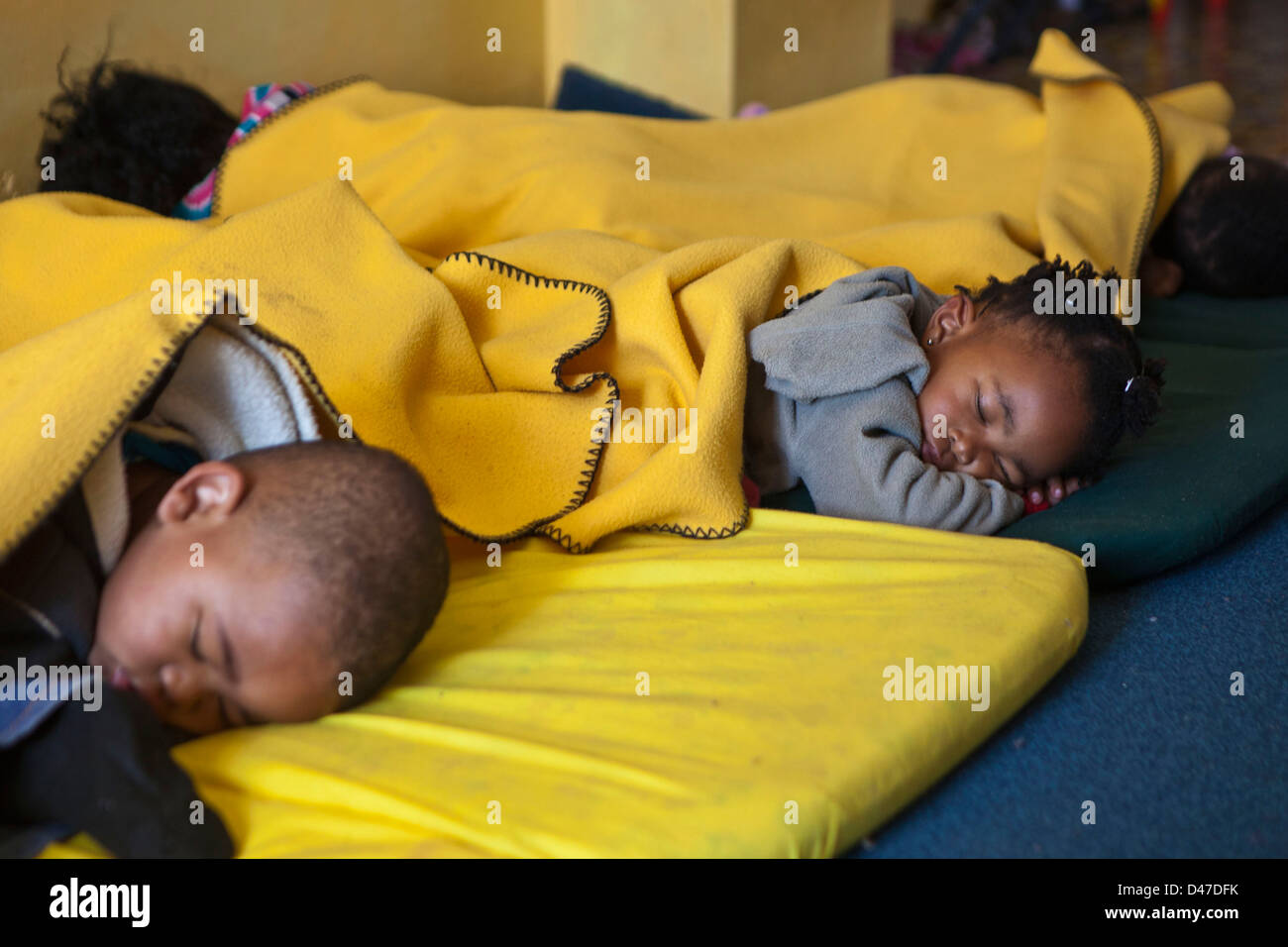 Children Sleeping On Floor Mats Stock Photos Children Sleeping