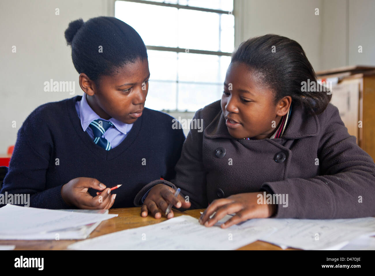 South African secondary high school children in a class in Sophumelela School, Philippi township, Cape Town, South - Stock Image
