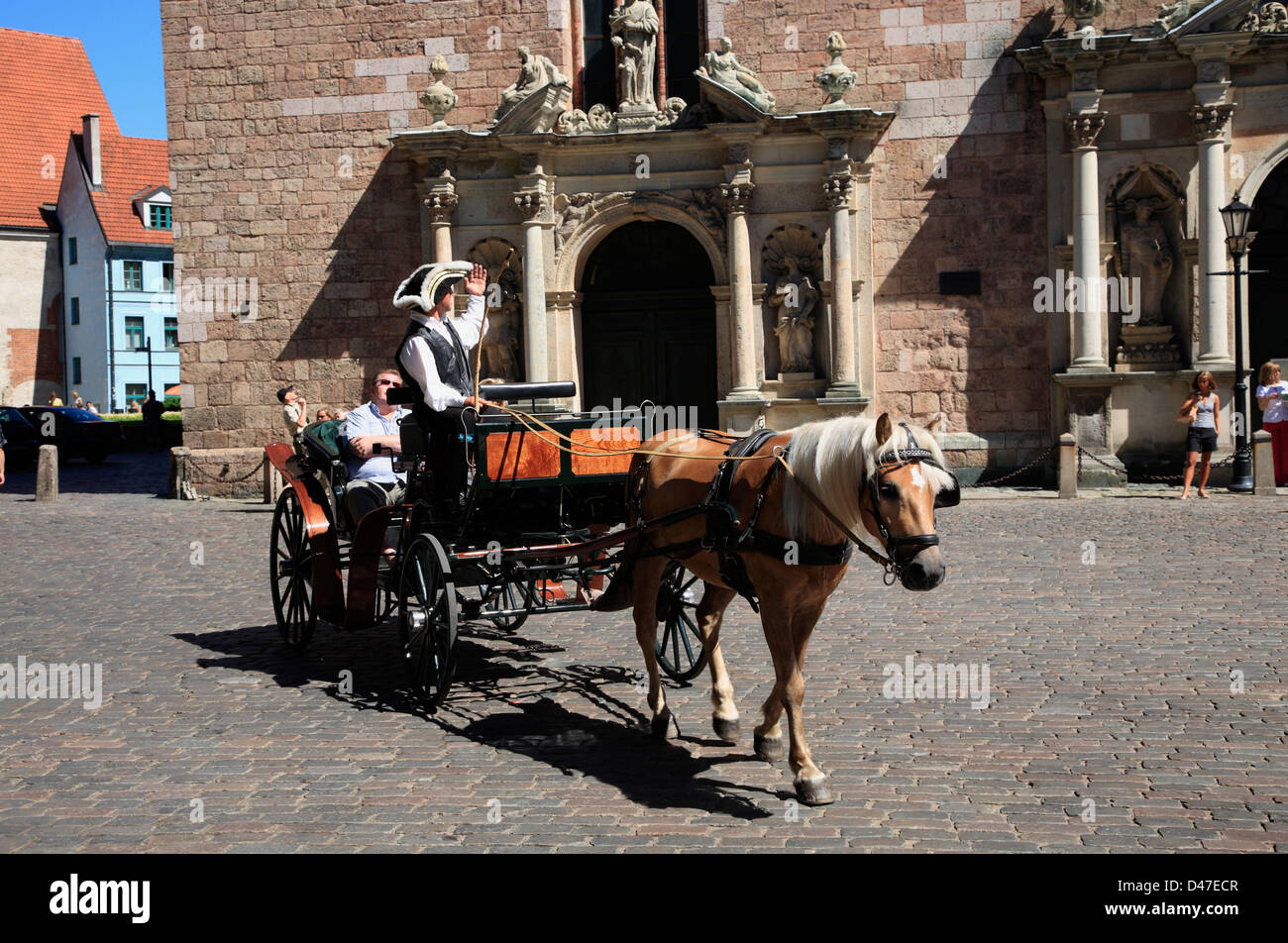 Horse-drawn carriage at  St. Peters church, Riga, Latvia - Stock Image