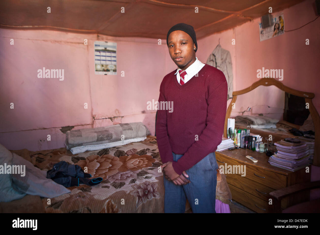 South African high school student, selected for a scholarship at home in his house in Philippi township, Cape Town. - Stock Image